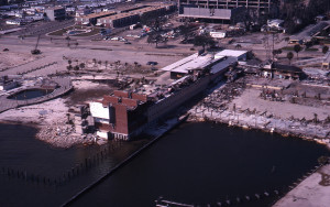 Color photo of buildings at a dock on Mobile Bay that were damaged by Camille