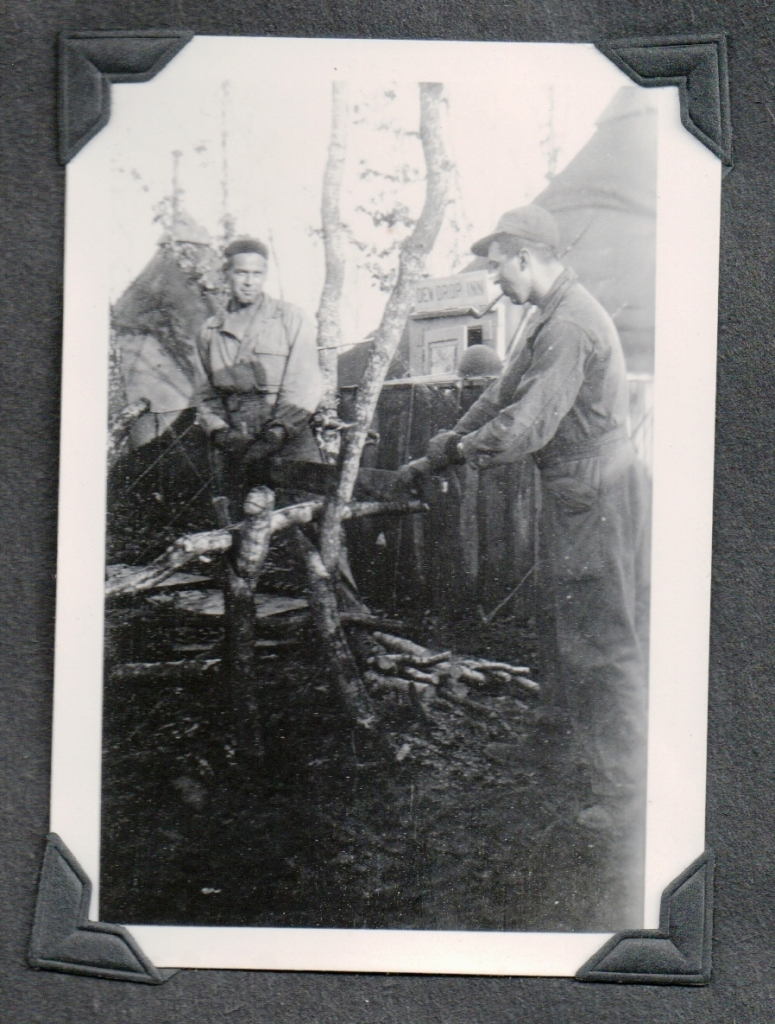 CLH WW2 Europe - Camp - back says Book and I sawing wood in CLH hand AND taken Nov 23 '44 in other hand