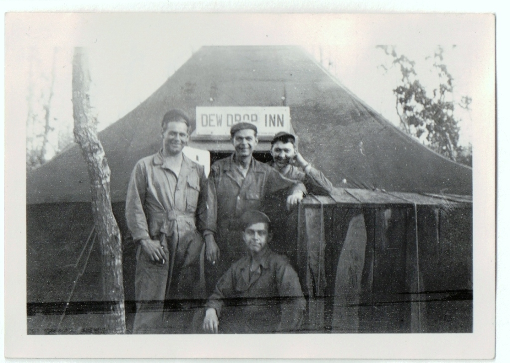 CLH WW2 Europe - Camp - in front of tent, back says Buck,Hall,Me,Donald in CLH hand,CLH standing on left-edited