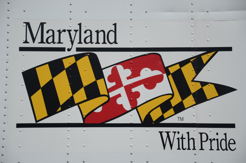 Maryland with Pride sign with images of state flag