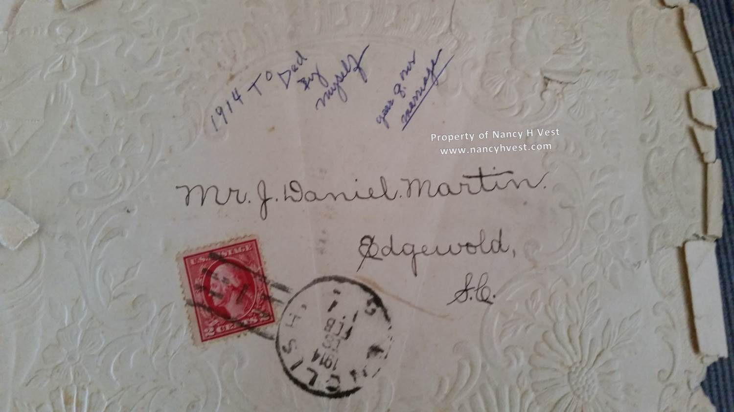 An embossed and ragged envelope which shows where my grandmother addressed it, and a notation in her hand about it being from the year they married.