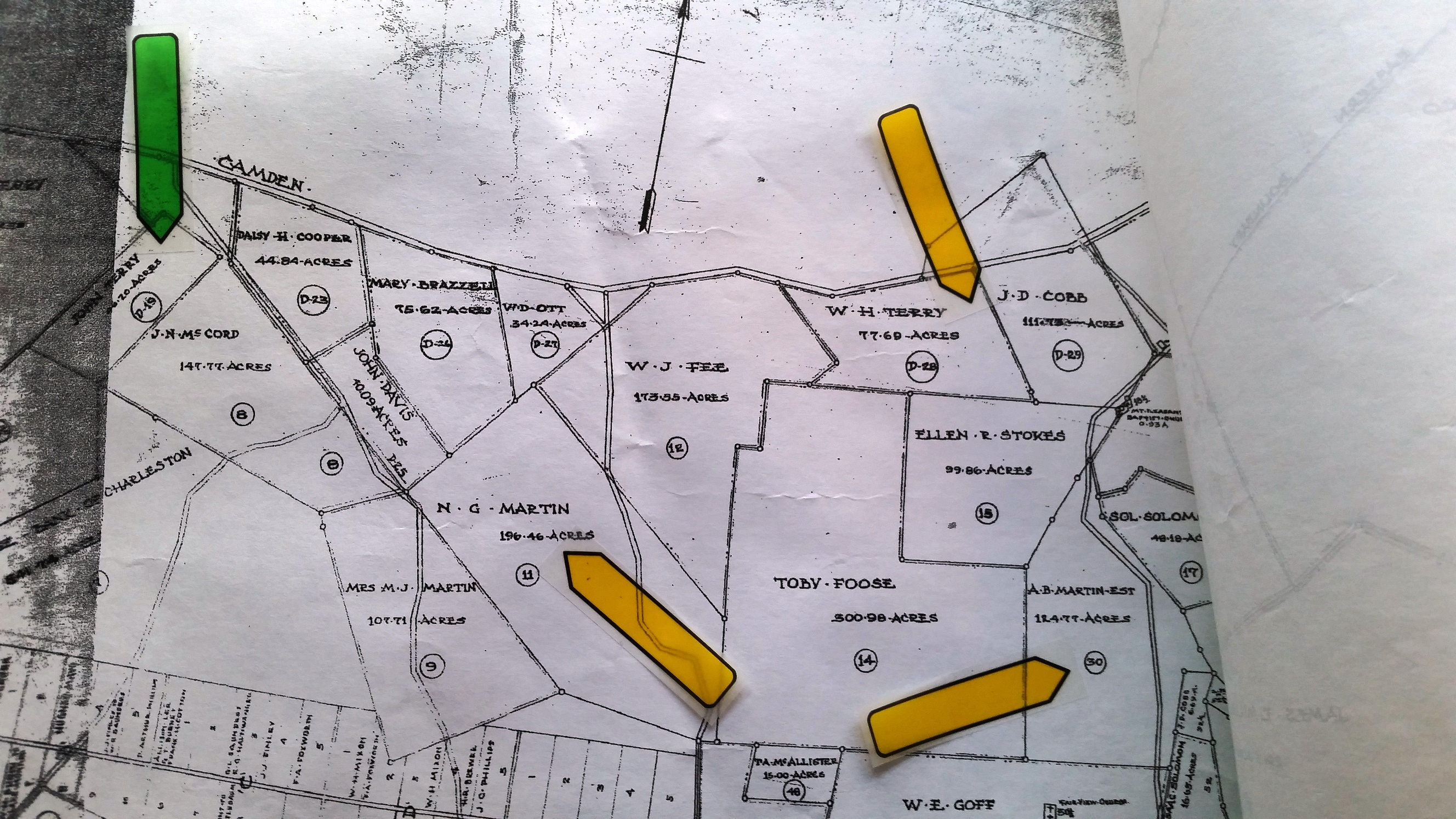 Survey map of a portion of the Fort Jackson Landowners' Map with a green arrow showing John Terry's land and 3 yellow arrows showing the land belonging to Narcissus Martin, Willie Terry, and Adolphus Martin. They are all close together.