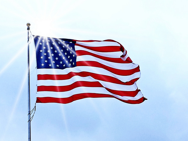 Photo of an American flag on a flagpole.