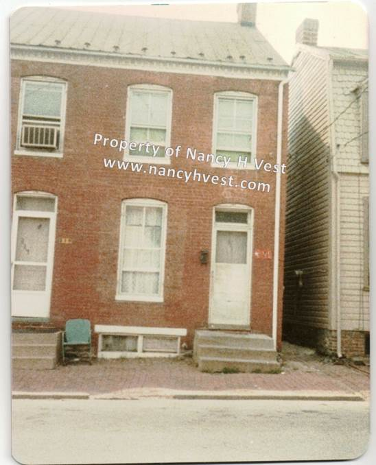 color photo of two brick row houses in Frederick, MD.