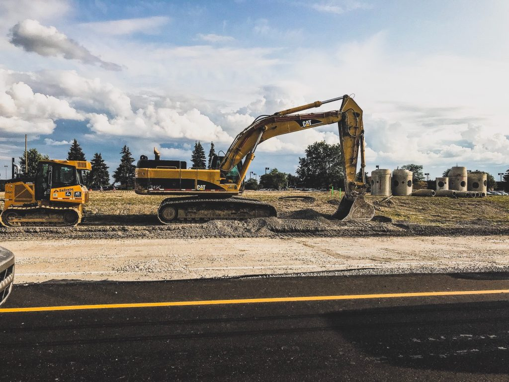 Color photo of construction equipment on the side of a new road