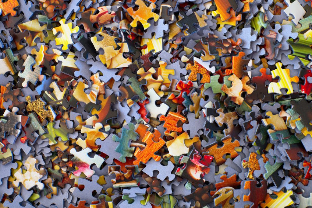 Color photo of a variety of puzzle pieces