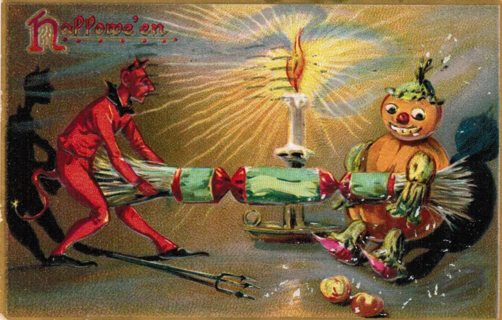 Color post card of a devil dressed in all red pulling a Christmas cracker toy with a pumpkin head man. There is also a burning candle in a candlestick on the background.