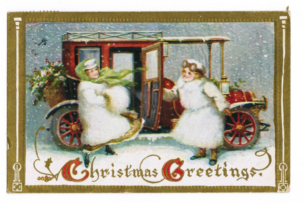 Vintage red car. A woman with driving glasses on is holding to car door for another woman who is wearing a green scarf. Both woman are wearing fluffy-looking white coats and hats, and dark colored shoes. 'Christmas Greetings' appears under them.