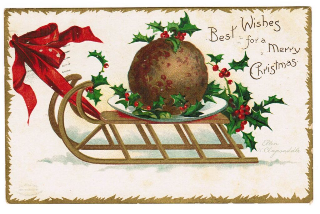Either a meatball or a Christmas pudding on a plate on a sleight with holly branches decorating it. Yes, it sounds strange. Well, it IS strange! On the upper right corner are the words: Best Wishes for a Merry Christmas.