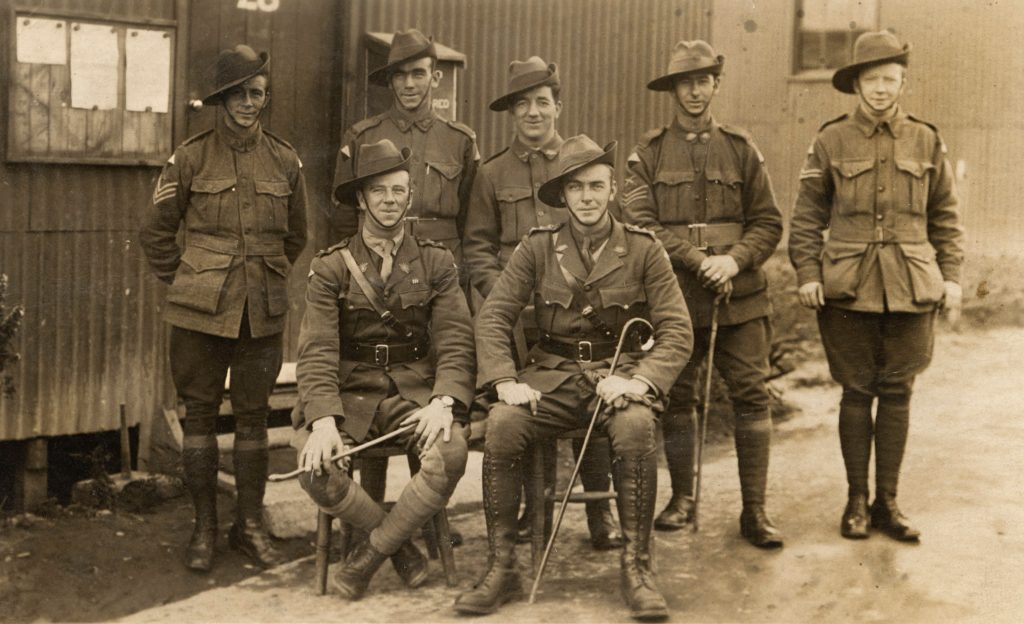 B&W photo of 7 WW1 soldiers from Australia. In uniform. Two seated in front. Five standing behind.