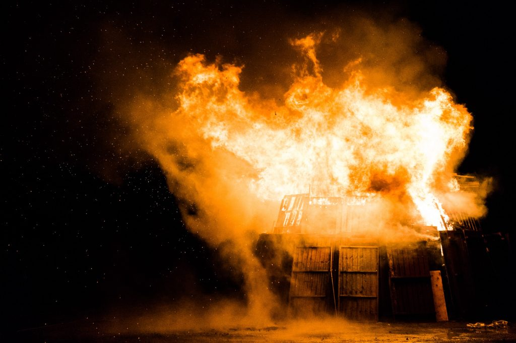 Wood structure on fire at night