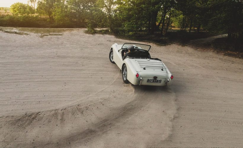 white convertible on sand